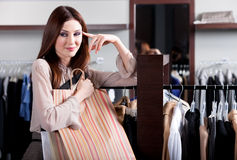 Satisfied with purchases woman carries paper packets with gifts Stock Photos
