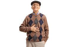 Satisfied senior after having a meal or a drink. Satisfied senior holding his hand on his stomach after having a meal or a drink isolated on white background Stock Photos