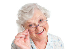 Satisfied senior woman with eyeglasses. Happy smiling retired lady wearing her new pair of glasses isolated on white background Stock Photo