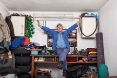 Satisfied senior worker in his workshop Stock Photography