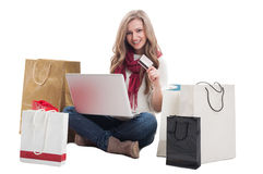 Satisfied shopping woman using credit or debit card Stock Photos
