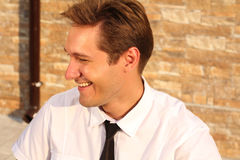 Satisfied smiling businessman, near house,. Outdoors Royalty Free Stock Photos