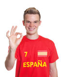 Satisfied spanish sports fan with blond hair Stock Photos