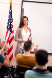 Satisfied teacher finished teaching and her students clapping ha Royalty Free Stock Images