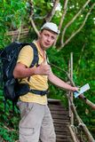 A satisfied tourist with a backpack and map. On the journey Stock Image
