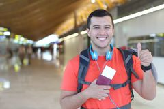 Satisfied traveler giving a thumbs up.  Royalty Free Stock Images