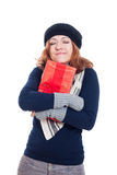 Satisfied winter woman with gift Royalty Free Stock Image