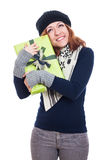 Satisfied winter woman with present Stock Photo