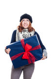 Satisfied woman with big gift looking up Royalty Free Stock Photos