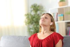 Free Satisfied Woman Breathing Fresh Air Using Earphones Stock Image - 165765061