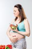Woman eats a delicious vegetable salad stock photos