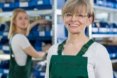 Satisfied woman in the factory Royalty Free Stock Images