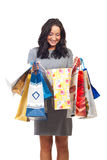 Satisfied woman of her shoppings. Satisfied woman of her shopping looking in bags isolated on white background royalty free stock images
