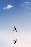 Satisfied woman jumping on the sky Stock Images