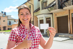 Satisfied woman with the keys to his new home Stock Photo