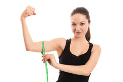 Satisfied woman measuring bicep Royalty Free Stock Photography