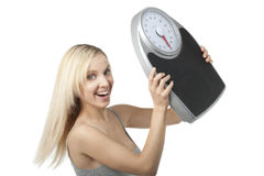 Satisfied woman raising her scale Stock Images