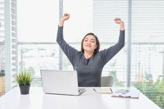 Satisfied woman relaxing with hands behind her head. Happy smiling employee after finish work, reading good news, break at work,. Girl doing simple exercise stock images