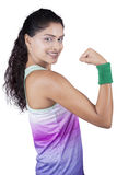 Satisfied woman showing her bicep Stock Photography