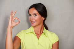 Satisfied woman showing ok sign and smiling Stock Photo