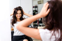 Satisfied woman smiling in the barbershop Stock Images