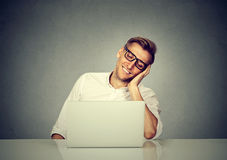 Satisfied with work done man sitting in front of laptop computer Stock Image