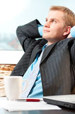 Satisfied young businessman resting. Portrait of a satisfied young businessman resting stock photography