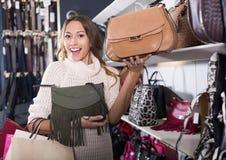 Satisfied young female shopping new handbag stock photos