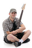 Satisfied young person holding a guitar Stock Images