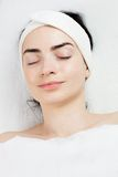Satisfied young woman with closed eyes portrait in Stock Photography