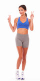 Satisfied young woman in sport clothing Stock Photos