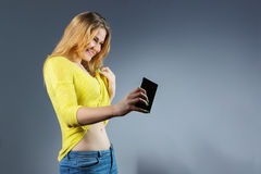 Satisfied young woman taking picture of her new fit body Stock Photos