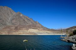 Satpara Lake with submerged PTDC motel sign Skardu Pakistan. Satpara Lake, Skardu, Pakistan - October 2, 2016: Satpara Lake is a natural lake near Skardu, Gilgit Royalty Free Stock Photo