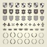 Sats av vapenskölden för riddaresköldar och kungliga emblem Arkivbild
