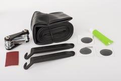 Sats för hjälpmedel för reparation för punktering för cykeldäckrör arkivfoto