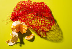 Satsuma with netting Stock Photos