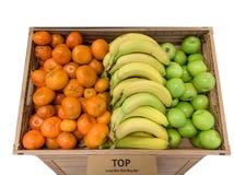Satsuma oranges, bananas and apples in a box stock image