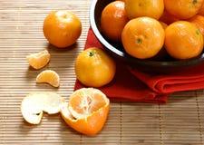 Satsuma oranges in a wooden bowl Royalty Free Stock Photos