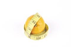Satsuma and Tape Measure Stock Photography