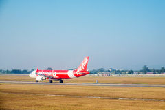 SATTAHIP, THAILAND - 21 DEC - Air Asia airline's passenger plane at U-Tapao airport with dried grass ground in Thailand Royalty Free Stock Photos