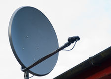 Sattelite dish on a house roof. Royalty Free Stock Photo