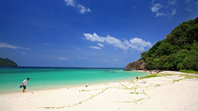 People on beach visit beautiful stone archway at Koh Khai Stock Images