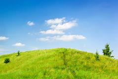 Saturated green hill Royalty Free Stock Image
