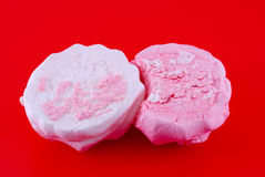 Saturated marshmallows on red. Marshmallow on the red background Royalty Free Stock Images