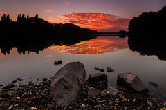 Saturated red sunrise over lake Royalty Free Stock Images