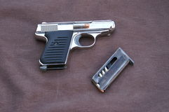 Saturday evening special. 22 pistol smaller the the palm of your hand easy to conceal stock images