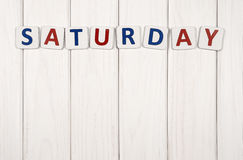 Saturday. Inscription on Saturday against a white wood texture royalty free stock photos
