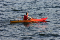 Saturday on lake union. A kayaker spends the day paddling away on the lake Stock Images