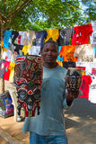 Saturday market in Maputo. MAPUTO, MOZAMBIQUE - APRIL 29: Unidentified man selling traditional african masks on the market in Maputo, Mozambique on April 29 Royalty Free Stock Photo
