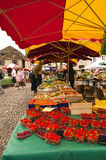 Saturday market Bretenoux France. Saturday market in the main square of Bretenoux France, man buys fruits Stock Photography